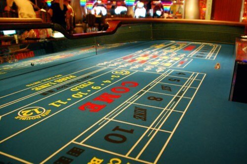 Craps tables are designed this way, so that the players can bounce the dice off the sidewalls.